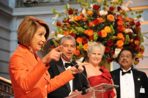 Nancy Pelosi during her speech, in the back ED Sam Ruiz, gala chair Tiffany Rasmussen and Board chair Jim Salinas, Sr. (Photo by Katia Fuentes, MNC)