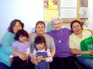 An OLVM sister sits with community members at the Julia Center, located in the Chicago area, where services and classes are available to new immigrants.