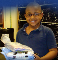 A student participant in the Assistance League of St. Louis' Operation School Bell--an innovative program that provides uniforms and other clothing to children in need. An IFF loan of $750,000 allowed the Assistance League of St. Louis to purchase its own expanded facility and attract new volunteers which resulted in a 30% increase in the the number of low-income students served through the program.