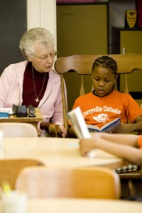 Sister Mary Ellen Carinato, SNDdeN, is a reading tutor to students at inner-city Corryville Catholic Elementary School in Cincinnati, OH.