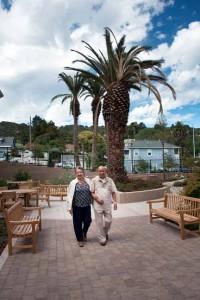 A couple walks through the courtyard at Berrellesa Palms. Photo by Treve Johnson.